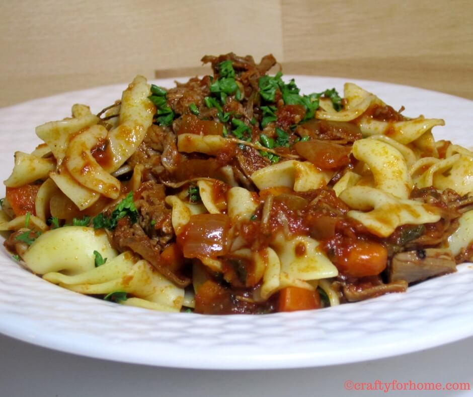 Slow cook ragu with broad noodle pasta