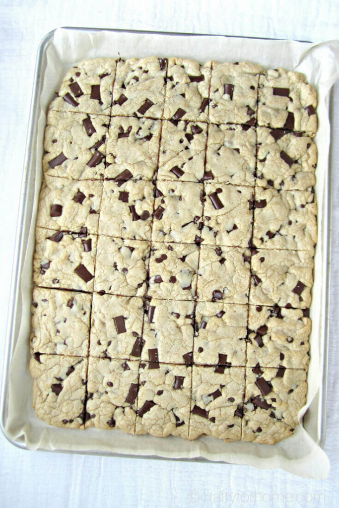 Chocolate Chunk Cookie Bars | Easy recipe for how to make chocolate chunk cookie bars. These cookie bars rich chunk of semi-sweet chocolate that has the perfect balance of sweet and quick baking cookie bars to feed the crowd. Soft, chewy, decadent, dairy-free, nut-free. #chocolatechunkcookies #dairyfreecookies #cookiebars #sheetpancookies #chocolatechipcookiebars #sheetpanblondies #dairyfreeblondies for full recipe on craftyforhome.com