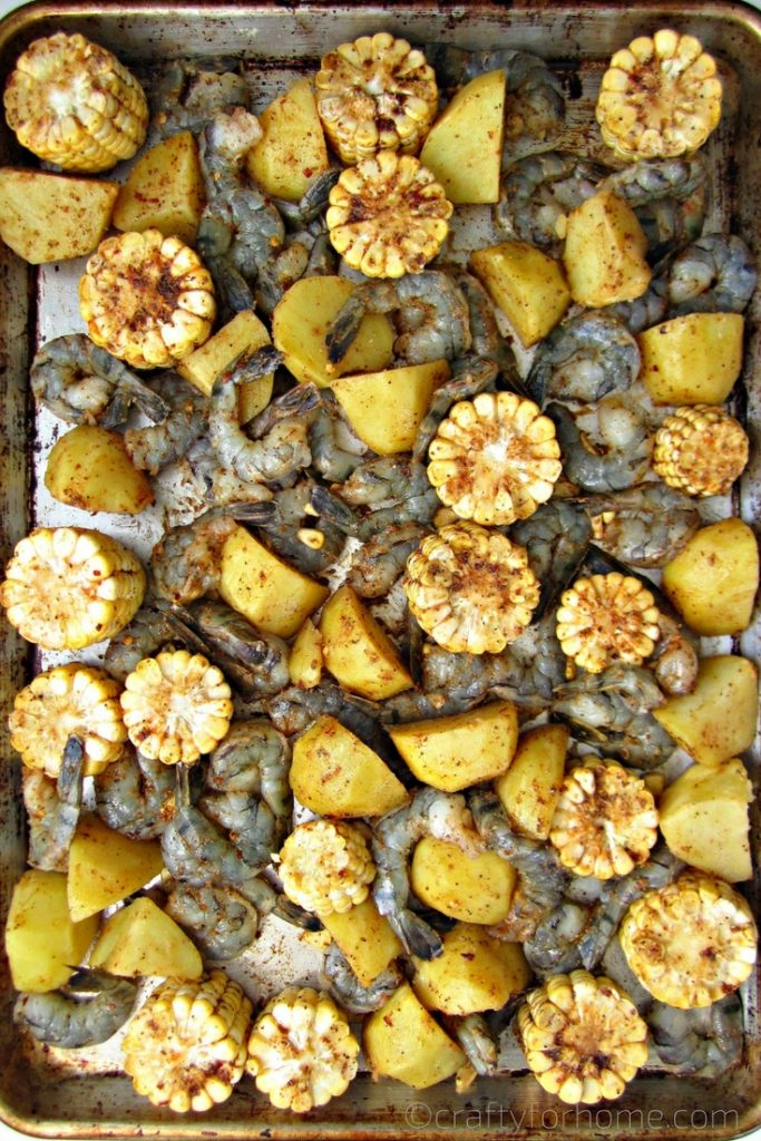 Healthy oven baked Sheet Pan Shrimp Boil recipe for a crowd with homemade seasonings #sheetpan #shrimpboil #shrimprecipe for full recipe on craftyforhome.com