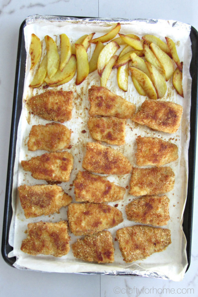 Oven baked fish and chips recipes on the sheet pan for an appetizer or finger foods ideas. Easy, kids friendly meal, dairy-free, healthy. For full recipe on craftyforhome.com