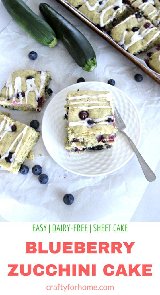 Easy dairy-free blueberry zucchini cake recipe with the lemon icing glaze. Bake it on the sheet pan to make cake bars. #dairyfree #sheetcake #zucchinicake #lemonicing for full recipe on craftyforhome.com