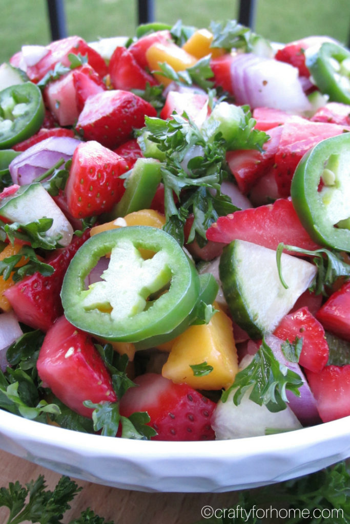 This strawberry salsa is easy, quick and fresh to serve for any summer party. Serve it on its own or a side dish for grilling season. #dairyfree #glutenfree #veganrecipes #strawberrysalsa for full recipe on craftyforhome.com
