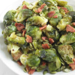 Easy oven roasted brussels sprouts recipe with maple glaze and topped it up with crispy bacon. A quick and simple meal for the family. Dairy-free, nut-free, gluten-free.
