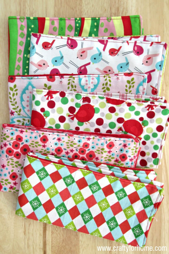 Handmade Cloth Napkins | Step by step tutorials on how to make double-sided cloth napkins for fat quarters project, perfect for DIY table decor on holiday season and fun homemade Christmas gift or any special occasion. #fatquartersproject #sewnapkins #reversiblenapkins #easyclothnapkins #DIYchristmasgift #10minutessewingproject #doublesidednapkins #homemadenapkins #handmadeclothnapkins for full tutorials on www.craftyforhome.com