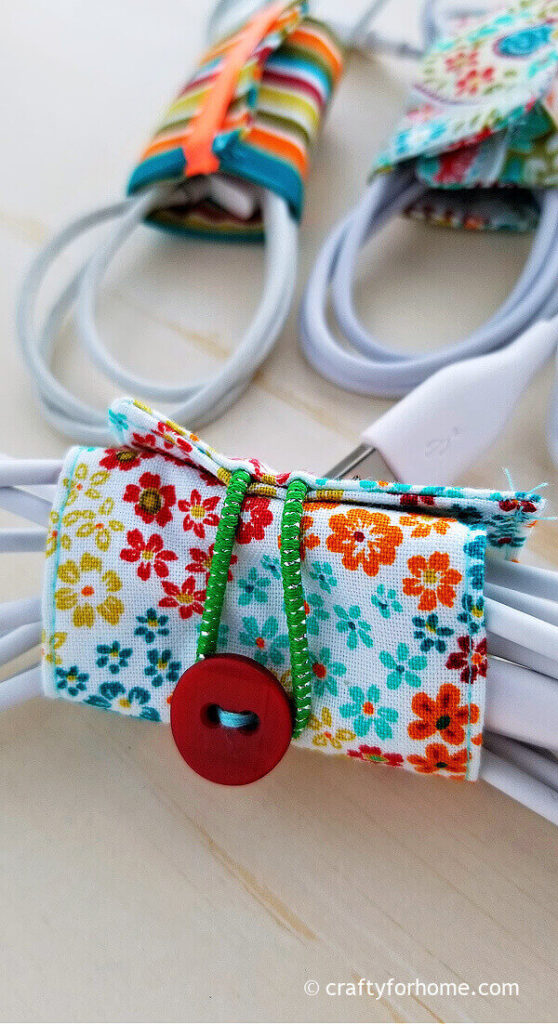 Fabric cord holder with hair elastic and button